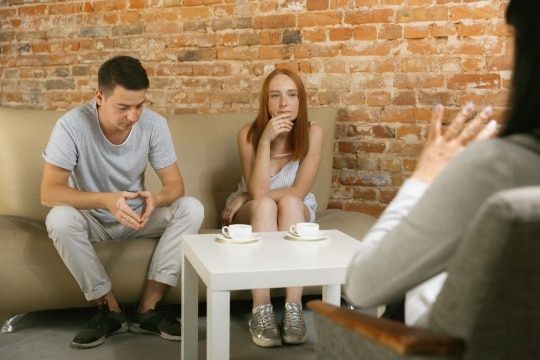 Couples listening to a marriage therapist