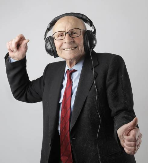 Old man listening to music while smiling